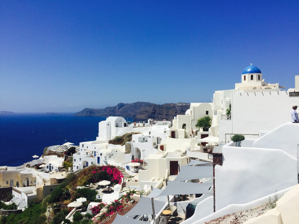 Germany has gone into strict lockdown in Santorini, Greece with white buildings and clear blue sky