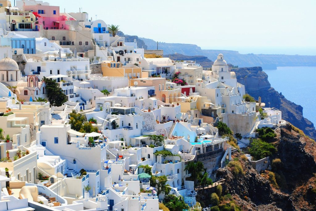 The whitewashed towns on the coast of Santorini are a must on our Greece Travel Guide