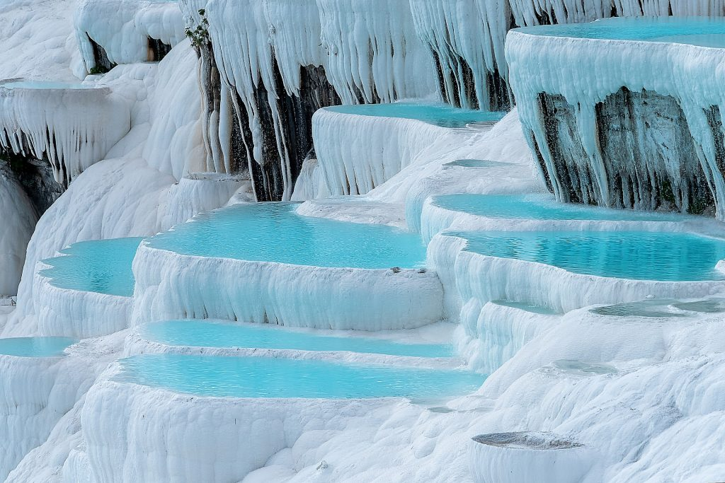 Pamukkale in Turkey with thermal blue pools is one of the most beautiful places in the world.
