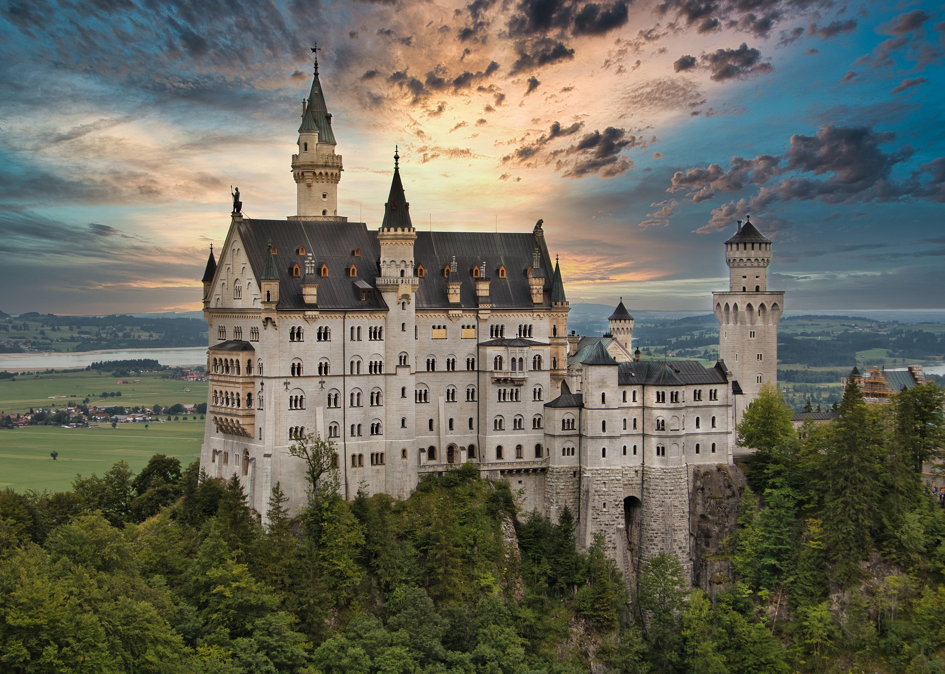 Massive white castle in Bavarian Germany with a cloudy sky