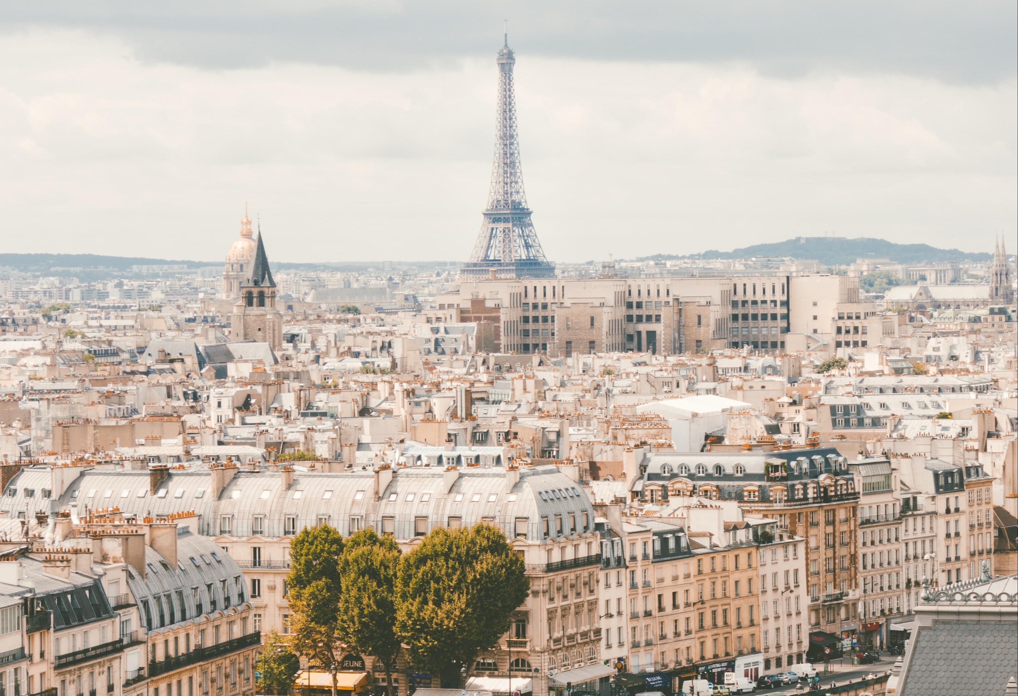 A city view of france with the Eiffel tower in the distance.