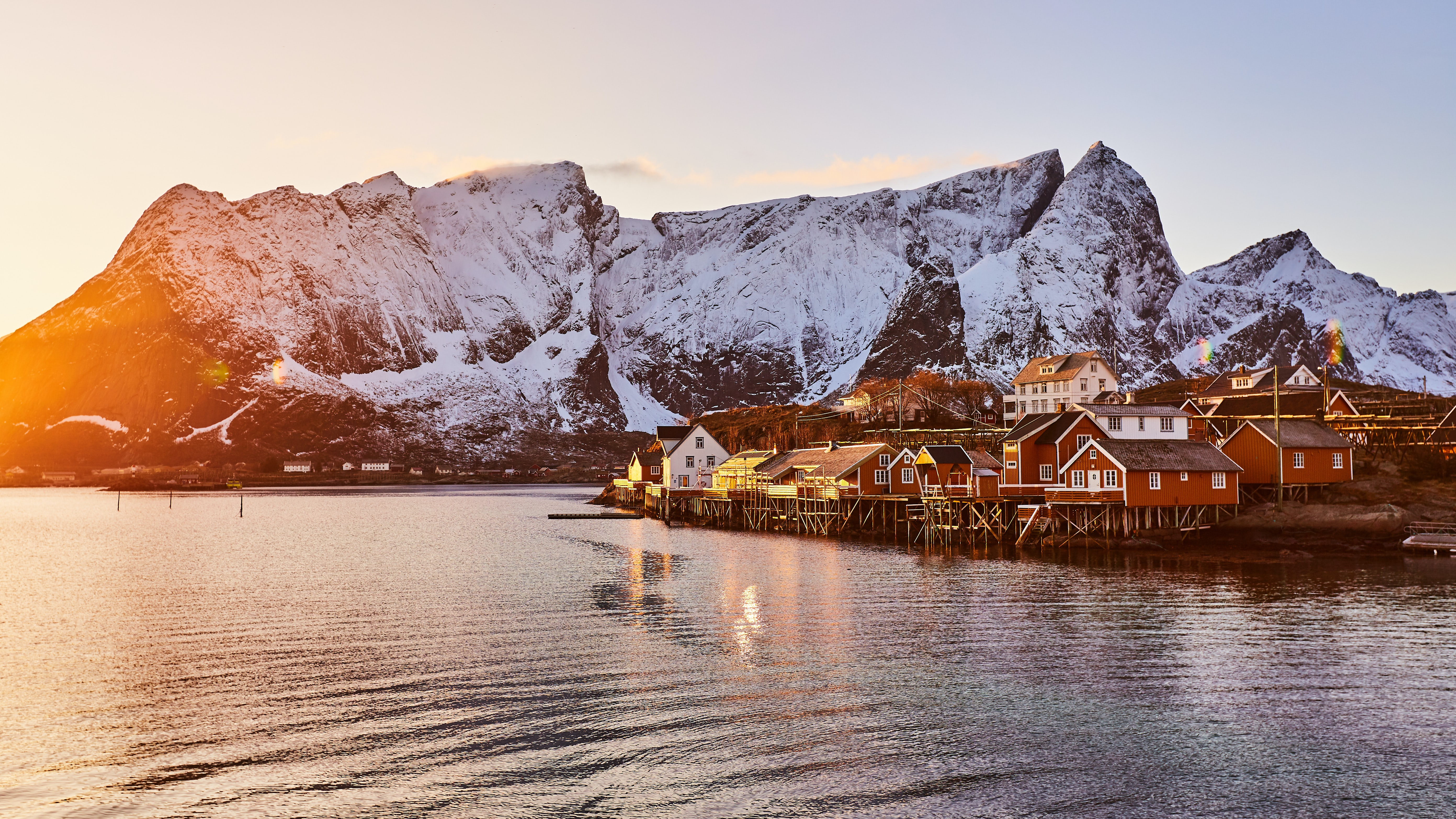 sunlight on a small Norwegian village and mountains