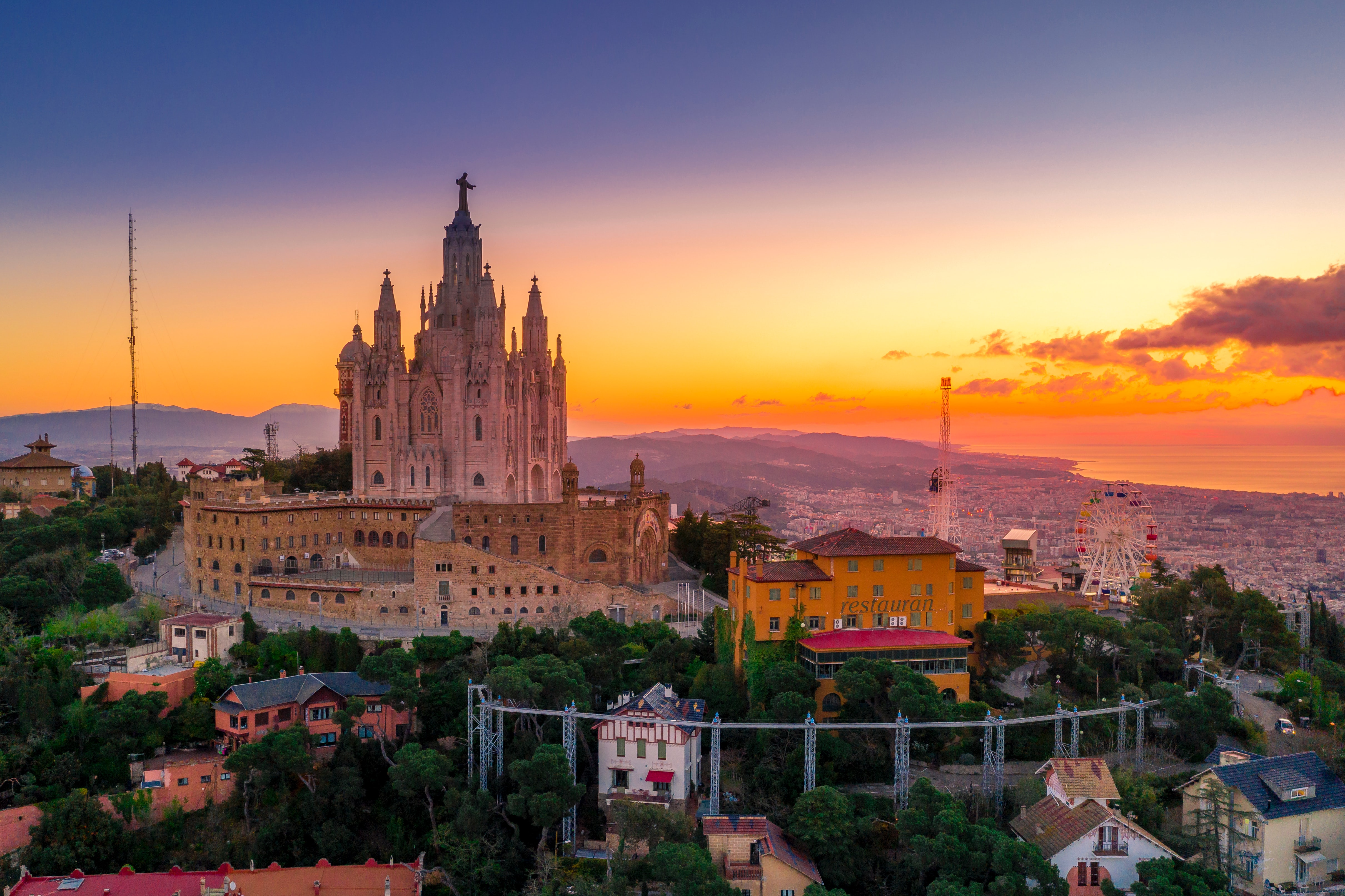 a view of Barcelona city in Spain with an orange sunset.