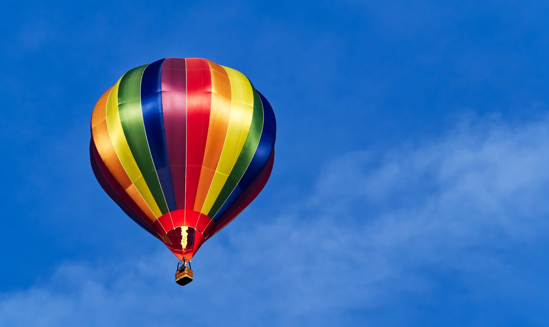 Hot air balloon with pride colors: where to travel based on pride colors