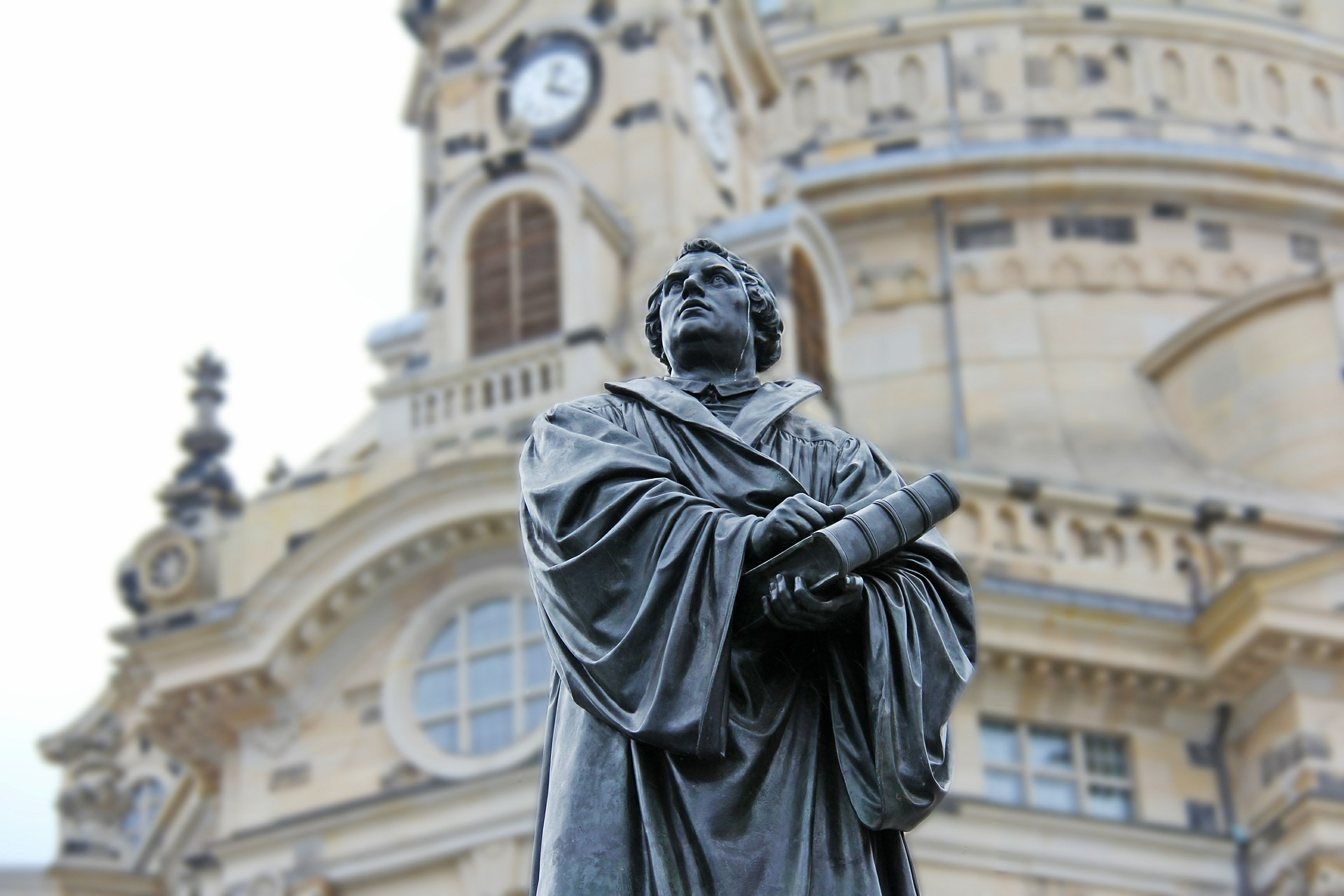 A statue of Martin Luther in front of a church in Germany